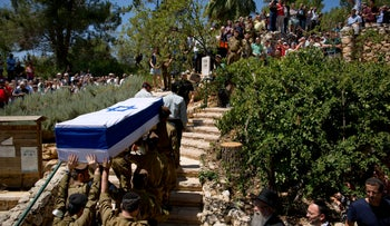 Israeli soldiers carry a coffin of an IDF Sargent, at the military cemetery in Jerusalem, July 23, 2014.