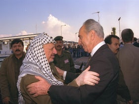 Shimon Peres meet with Yasser Arafat at the erez checkpoint entrance to Gaza, 1995.