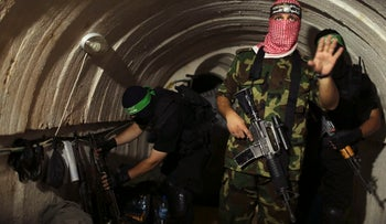Hamas operatives inside an underground tunnel in Gaza on August 18, 2014.