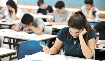 Students taking a matriculation exam at a high school in Hadera.