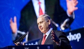 Prime Minister Benjamin Netanyahu speaking at the International Cybersecurity Conference at Tel Aviv University on September 14, 2014.