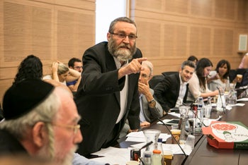 MK Moshe Gafni at a meeting of the Knesset's Finance Committee, August 12, 2014.