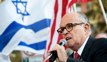 """Former N.Y.C. Mayor Rudy Giuliani speaking before protesters outside the Metropolitan Opera, on opening night of the opera """"The Death of Klinghoffer,"""" October 20, 2014."""