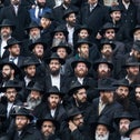 Rabbis pose for a group photo in front of Chabad-Lubavitch world headquarters in Brooklyn, New York, Nov. 23, 2014.
