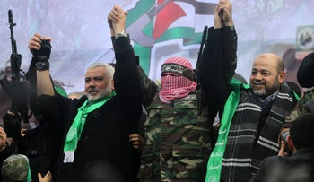 Hamas official Moussa Abu Marzuq, on the right, greeting supporters in Gaza City in 2014.