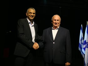 Finance Minister Moshe Kahlon, left, and Eli Alalouf standing together on a stage in an undated photo.