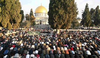 Worshippers pray outside the Al-Aqsa Mosque in Jerusalem on the first day of Id al-Adha, January 10, 2006.