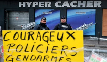 French police officers guard the kosher grocery where Amedy Coulibaly killed four people.
