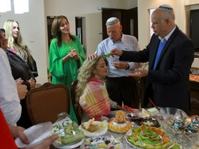 An Israeli family in Ashdod celebrating Mimouna, the Moroccan Jewish festival marking the end of Passover, April 11, 2015.