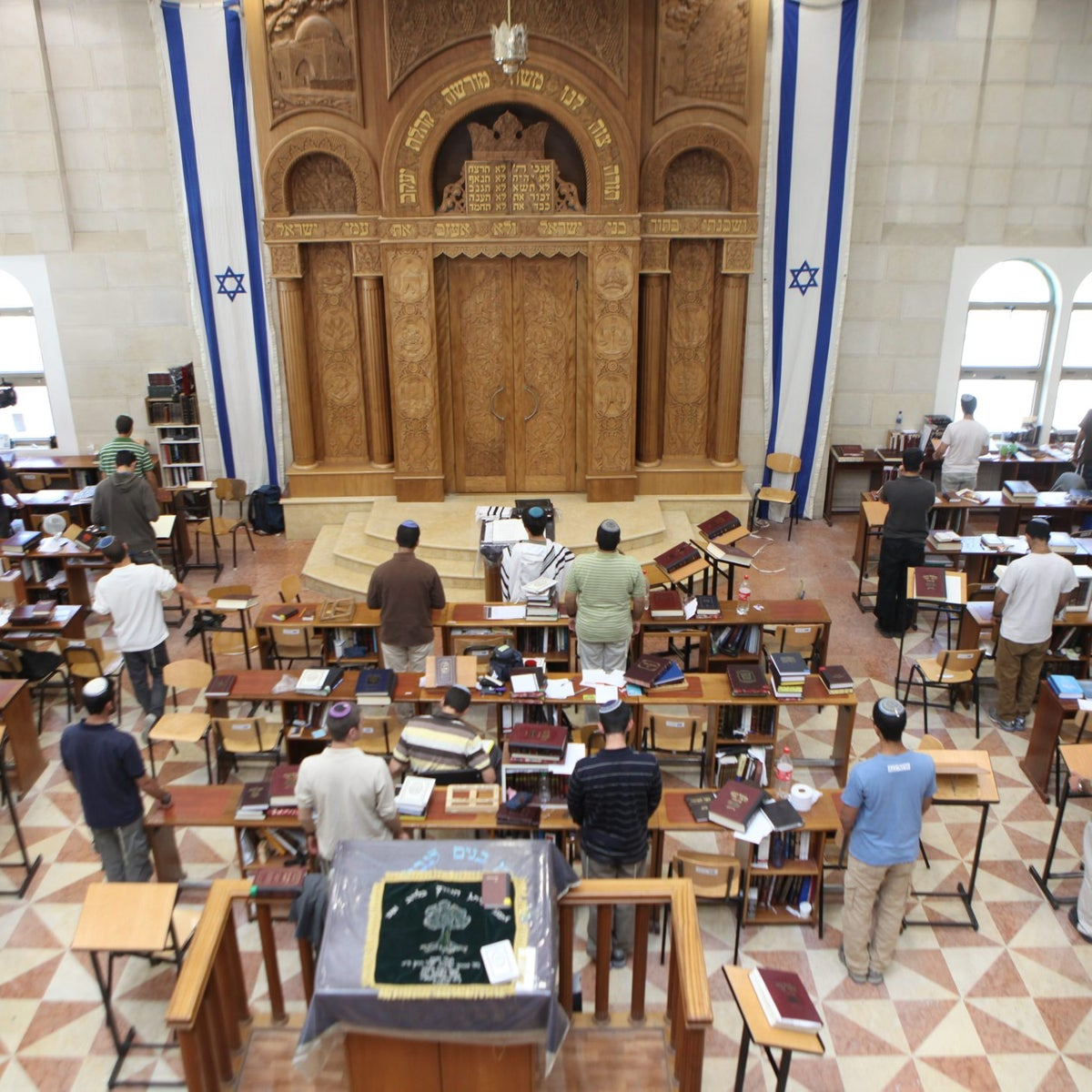 Students praying at the Shavei Hevron yeshiva in Kiryat Arba in 2011.