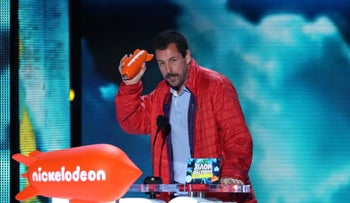 Adam Sandler accepts the award for favorite animated movie at the Kids' Choice Awards, March 12, 2016.