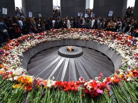 People lay flowers at the Tsitsernakaberd Armenian Genocide Memorial in Yerevan, April 21, 2015.