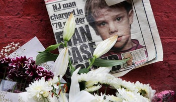 File Photo: A newspaper with a photograph of Etan Patz at a makeshift memorial in the SoHo neighborhood of New York where Patz had lived. May, 2012.