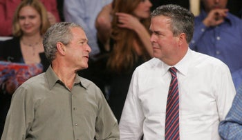 In this 2006 file photo, George W. Bush jokes with his brother, Jeb Bush, in Florida.