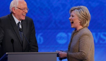 Democratic U.S. presidential candidates U.S. Senator Bernie Sanders and former Secretary of State Hillary Clinton share a laugh at the start of a commercial break during the Democratic presidential candidates debate at St. Anselm College in New Hampshire December 19, 2015.
