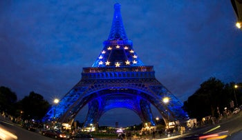 The Eiffel Tower is seen lit in the blue and yellow colors of the European Union flag to mark France's six-month presidency of the European Union, July 6, 2008.