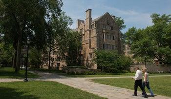 Pedestrians walk down a path on the Yale University campus in New Haven, Connecticut, U.S., on Friday, June 12, 2015.