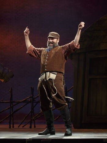 """Danny Burstein sings and dances on stage in the new Broadway production of """"Fiddler on the Roof."""""""