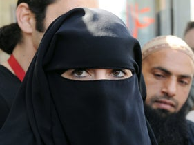 A Muslim woman wearing a full-face veil, France.
