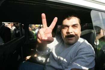 Samir Kuntar makes a victory sign to the crowd following his release from an Israeli jail in 2008.