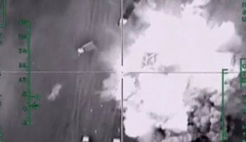 A frame grab taken from footage released by Russia's Defense Ministry December 4, 2015, shows strikes by Russia's air force hitting trucks carrying oil, which, according to the ministry, are controlled by the Islamic State militants, in Aleppo in Syria.