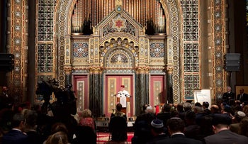 Andre Azoulay, Counselor to King Mohammed VI of Morocco delivering a message from the monarch in front of the Holy Ark of Congregation B'nai Jershurun at the KIVUNIM event.