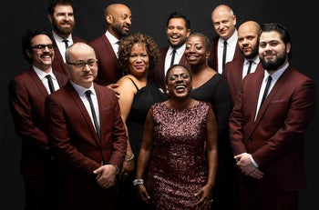Gabe Roth, far left with horseshoe mustache, leads Sharon Jones and the Dap Kings, a meticulously retro soul group with several Jewish members.