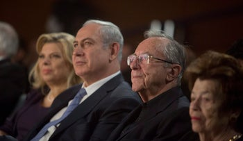 Moshe Arens. center-right, sits next to Benjamin Netanyahu and his wife Sara, during the former's 90th birthday anniversary.