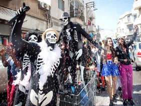 A Purim parade in Tel Aviv: Could the custom of costumes have originated in pre-Lent festivities?