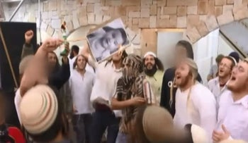 Screenshot from wedding video shows men burning a photo of Ali Dawabsheh, a Palestinian baby killed with his mother Reham and father Saad in the arson attack on the family home in Duma.