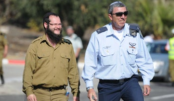 Chief Military Rabbi Brig. Gen. Rafi Peretz (right) at a Northern Command ceremony, November 2014