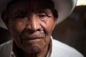 In this Dec. 11, 2015 photo, Fernando Osorio, a surviver of the Rio Negro massacre, poses for photos after giving his testimony to the Guatemalan Forensic Anthropology Foundation FAFG in Guatemala.