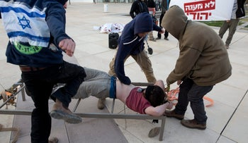 Right-wing activists reenact torture methods they claim were used against Jewish terror suspects.