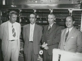 An undated photo of John von Neumann (right) with Julian Bigelow (left), Herman Goldstine and J. Robert Oppenheimer at Princeton Institute for Advanced Study.