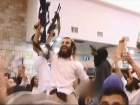 A screenshot from wedding video shows attendees brandishing weapons and a Molotov cocktail.
