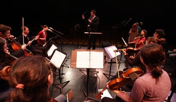 CENTER OF ATTENTION: Oran Eldor conducts an orchestra. 'I'd love to do something big in Israel.'