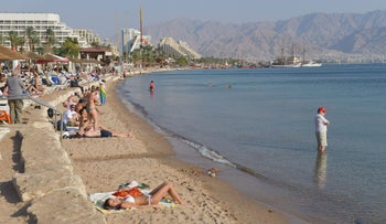 Tourists on the beach in Eilat.