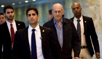 Ehud Olmert arrives at the Supreme Court in Jerusalem December 29, 2015.
