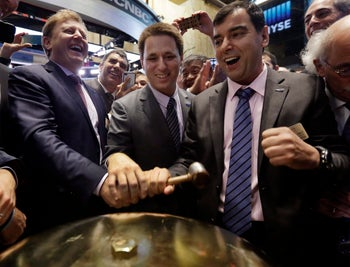 Mobileye President & CEO Ziv Aviramon, CFO Ofer Maharshak, and Chairman Amnon Shashua, prepare to ring a ceremonial bell as their company's IPO begins trading, on the floor of the NYSE, Aug. 1, 2014.