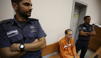 Organized crime boss Asi Abutbul in court, May 26, 2015, on suspicion of involvement in 2008 car-bomb killing of attorney Yoram Hacham. Abutbul was later released.