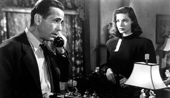 Humphrey Bogart with his wife Lauren Bacall, shown playing in 'The Big Sleep', were both clients of Irving Lazar. After Lazar obtained 3 contracts for him im a day, Bogart nicknamed him 'Swifty'. Lazar was not appreciative.