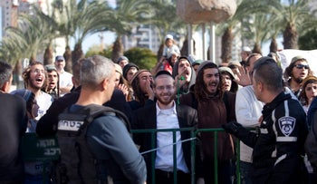 Supporters of the suspects in the West Bank arson case gather outside the Petah Tikva Magistrate's Court, December 28, 2015.