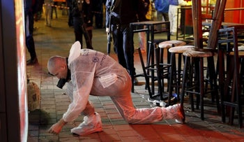 At the scene of a deadly shooting attack in Tel Aviv on Friday, January 1, 2016.