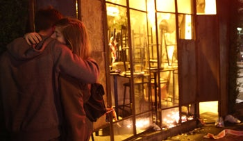 Mourners comfort one another at the scene of a shooting attack in downtown Tel Aviv on January 1, 2016.