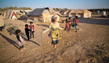 Syrian children playing at a tent refugee camp in Jordan