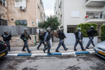 Policemen searching for the assailant who killed two and wounded seven at a central Tel Aviv bar, January 1, 2016.