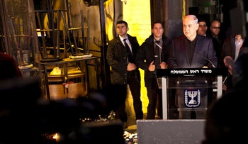 Netanyahu speaking at the site of an attack that killed two and wounded seven in Tel Aviv, December 2, 2016.