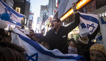 Pro-Israel demonstrators chant slogans as pro-Palestinian protesters walk past a peace protest in Times Square in the Manhattan borough of New York October 18, 2015.