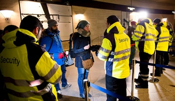 Security personal check IDs at Kastrups train station outside Copenhagen, Denmark, January 4, 2016.