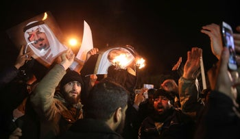 Iranian protesters gather outside the Saudi Embassy in Tehran during a demonstration against the execution of prominent Shi'ite Muslim cleric Nimr al-Nimr by Saudi authorities, on January 2, 2016.